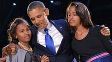 President Obama and his daughters Sasha and Malia.