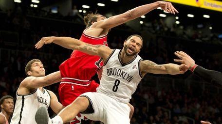 Chicago Bulls center Joakim Noah slaps the ball