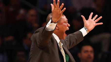 Doc Rivers of the Boston Celtics argues a
