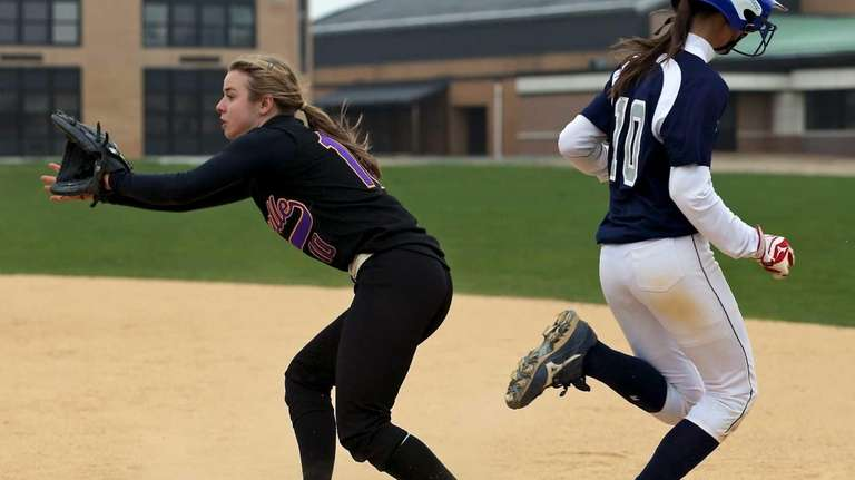 Eastport's Kailah Konkel beats the throw to first