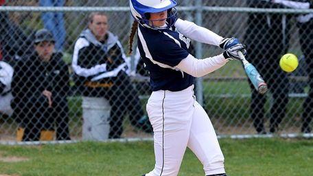Eastport's Hope Brenkert drives the ball deep to
