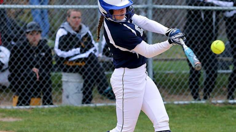 Eastport's Hope Brenkert drives the ball deep to