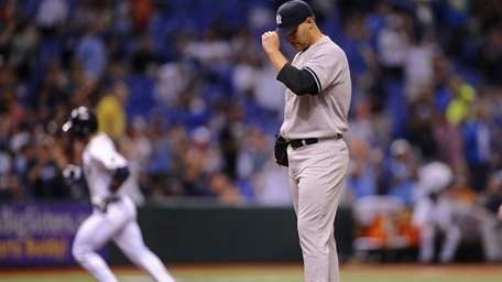 Andy Pettitte reacts on the mound as the