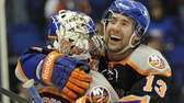 New York Islanders' Colin McDonald (13) hugs goalie