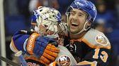 New York Islanders' Colin McDonald (13) hugs goalie