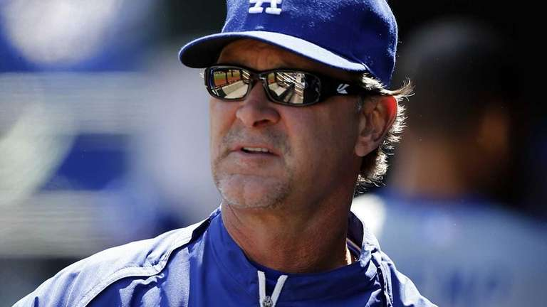 Dodgers manager Don Mattingly looks on before the