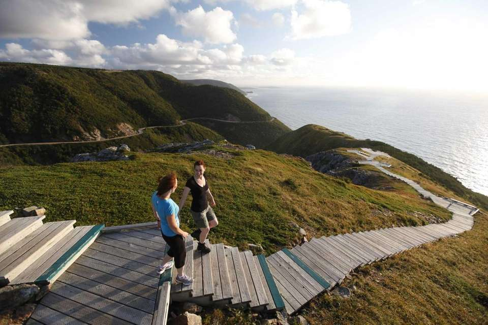 Visitors hike the Skyline Trail in Cape Breton
