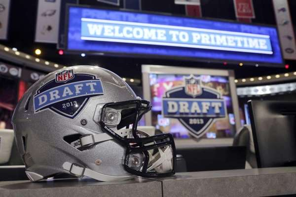 A helmet with the NFL football draft logo