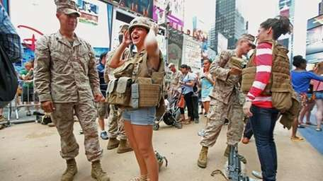 Civilians try on military gear with U.S. Marines