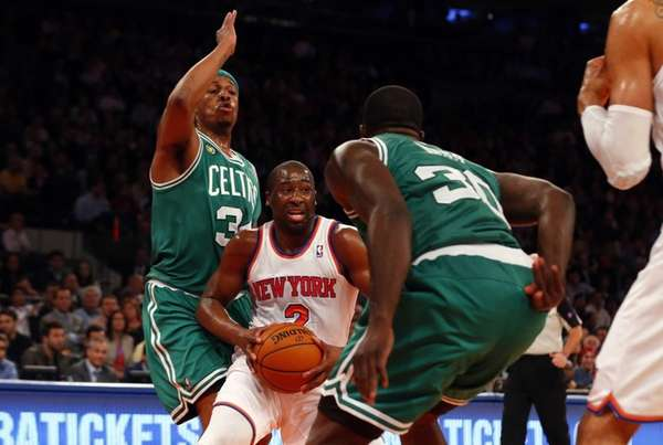 Raymond Felton drives between the Boston Celtics' Brandon