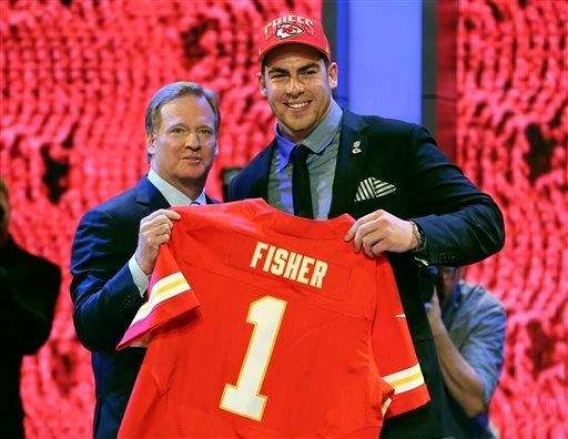 Central Michigan tackle Eric Fisher stands with NFL