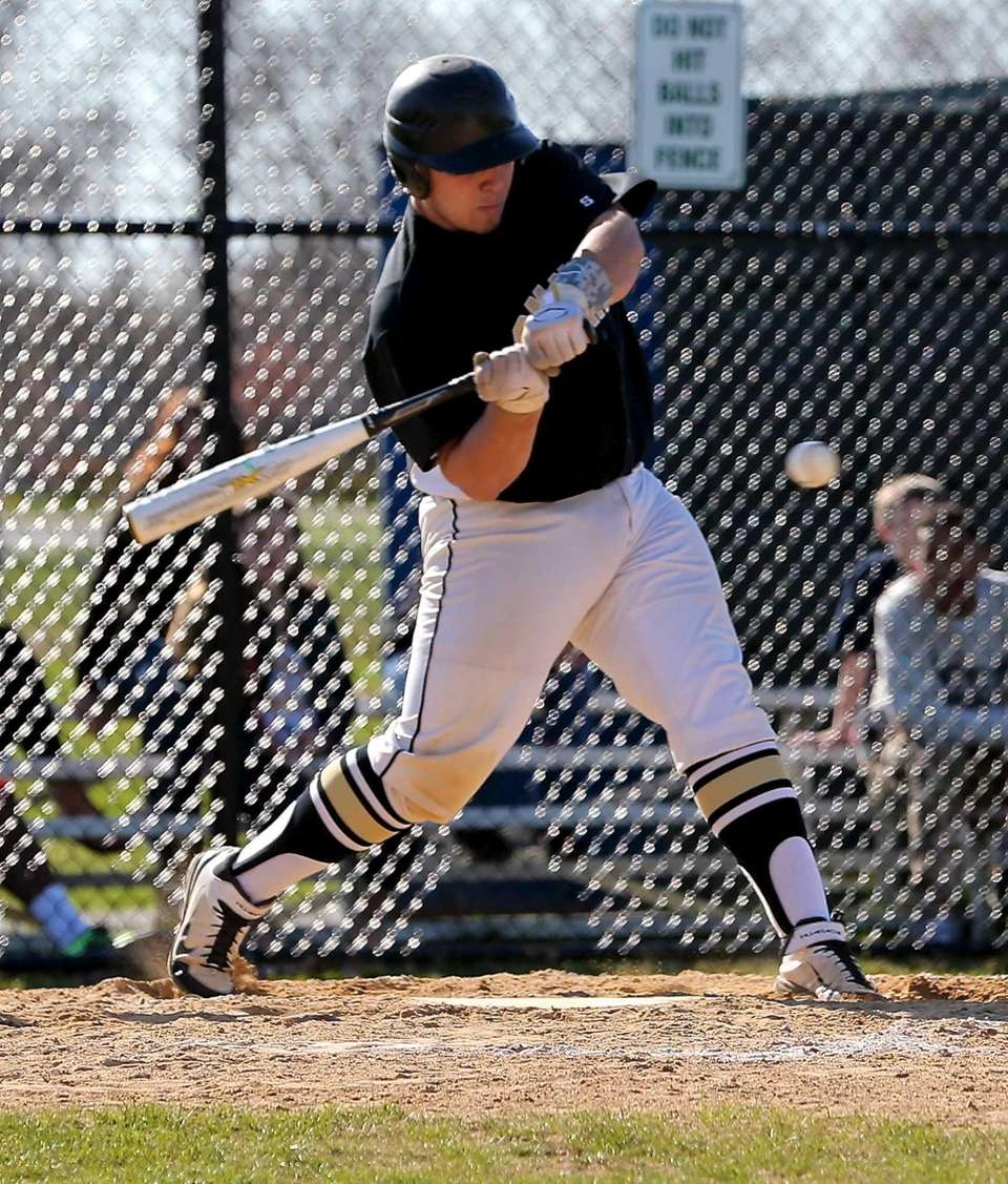 Commack's Stephen Catalano strokes a single to the