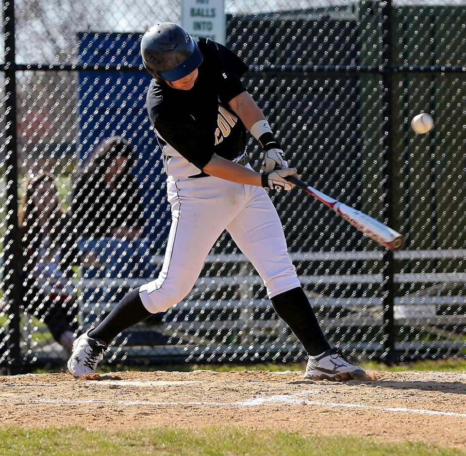 Commack's Bobby Morse drives the ball over the