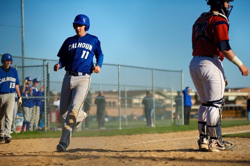 Calhoun first baseman Kevin Hiss (11) comes home