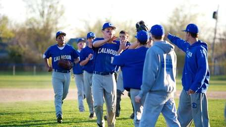 Calhoun center fielder Tommy Joannou (15) celebrates with