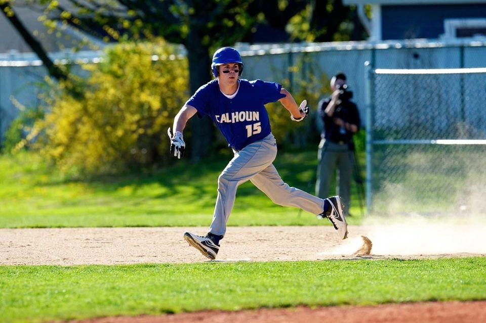 Calhoun center fielder Tommy Joannou (15) attempts to
