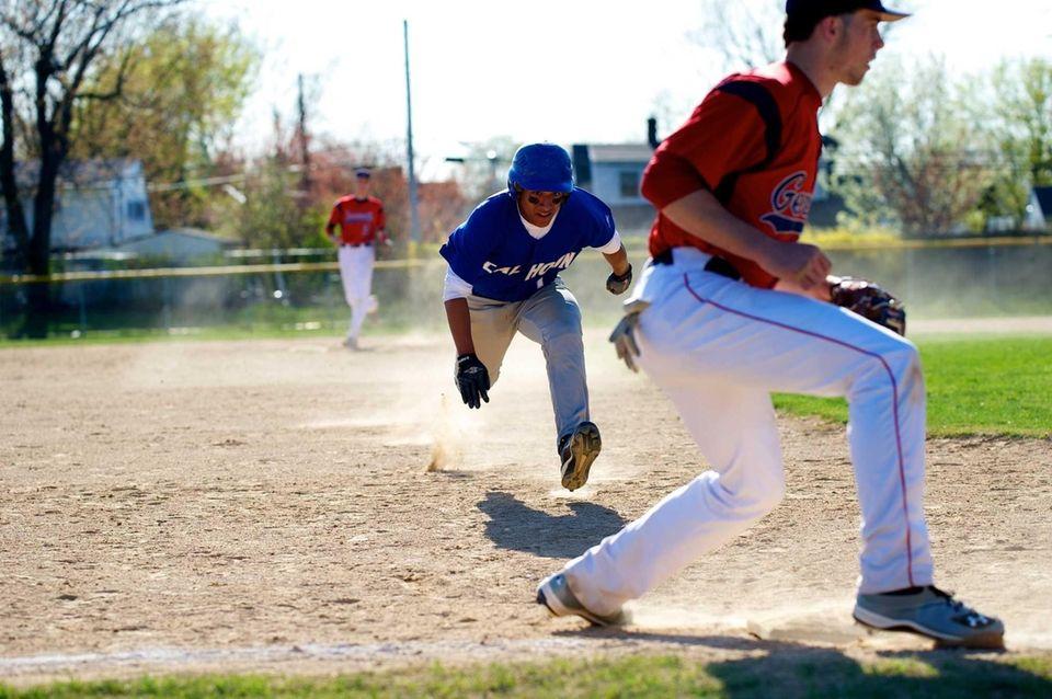 Andrew Cordova (4) slides safely into third base