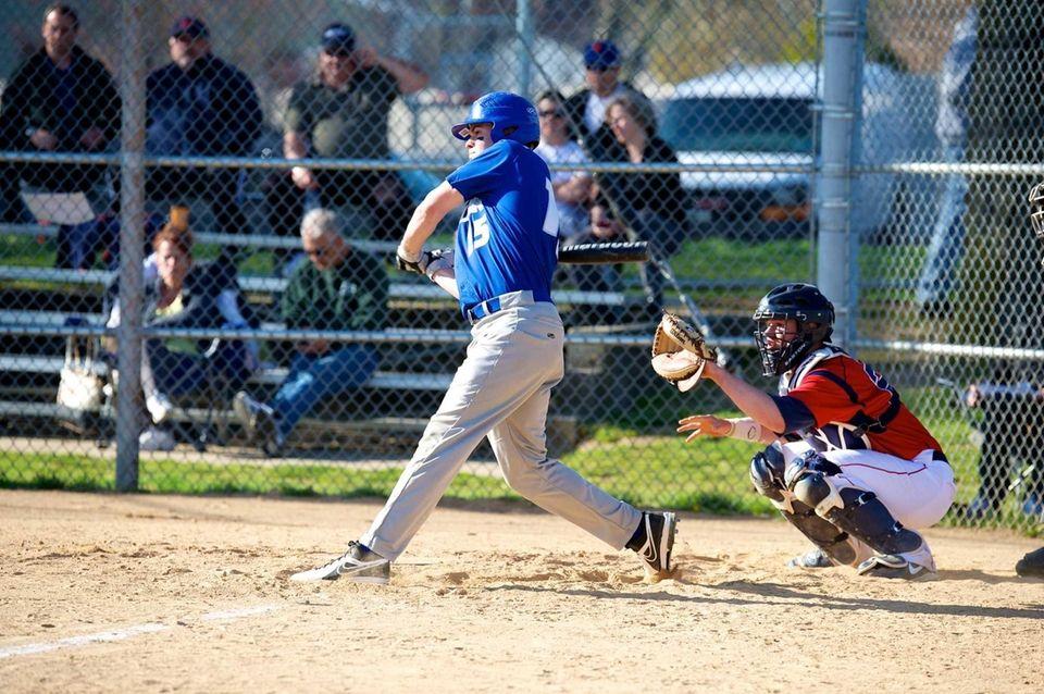 Calhoun center fielder Tommy Joannou (15) swings at