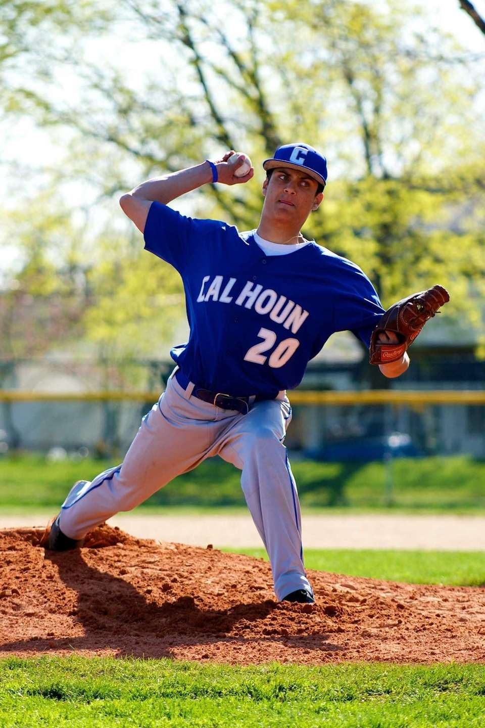Calhoun pitcher Zach Mastrangelo (20) delivers a pitch