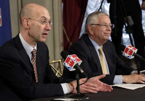 NBA Deputy Commissioner Adam Silver, left, accompanied by