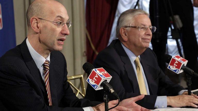 NBA Deputy Commissioner Adam Silver, left, accompanied by