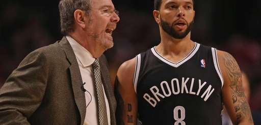 P.J. Carlesimo talks with Deron Williams #8 as