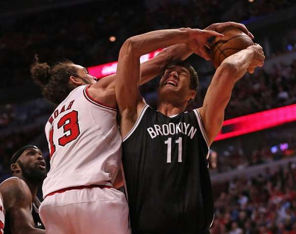 Joakim Noah of the Chicago Bulls fouls Brook