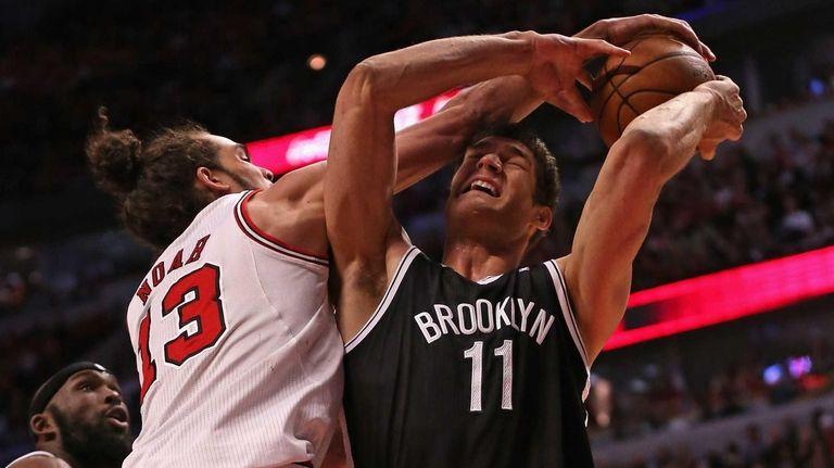 Joakim Noah of the Chicago Bulls fouls Brook