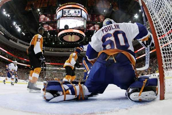 Kevin Poulin blocks a shot as the Philadelphia