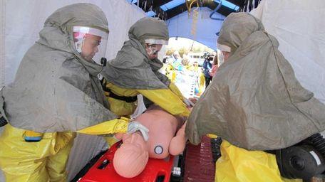 Emergency personal participate in a FEMA Center for