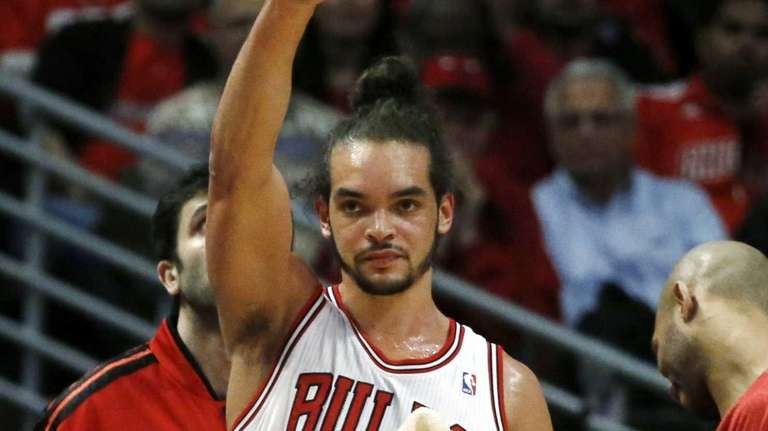 Chicago Bulls center Joakim Noah acknowledges the play