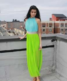 An airy pleated dress in brilliant colors is
