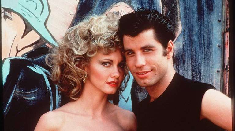 Olivia Newton-John as Sandy and and John Travolta