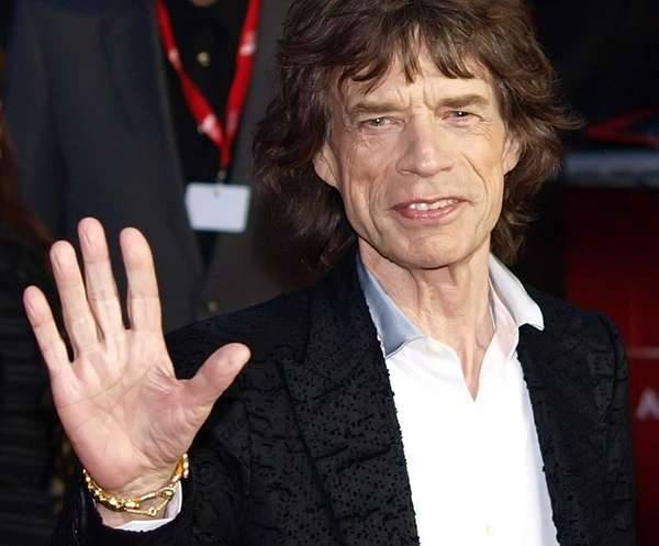 "Mick Jagger arrives for the premiere of ""Crossfire"