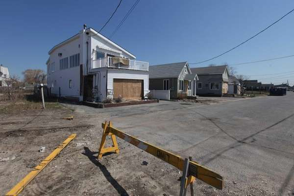 Six months after superstorm Sandy, homes on West