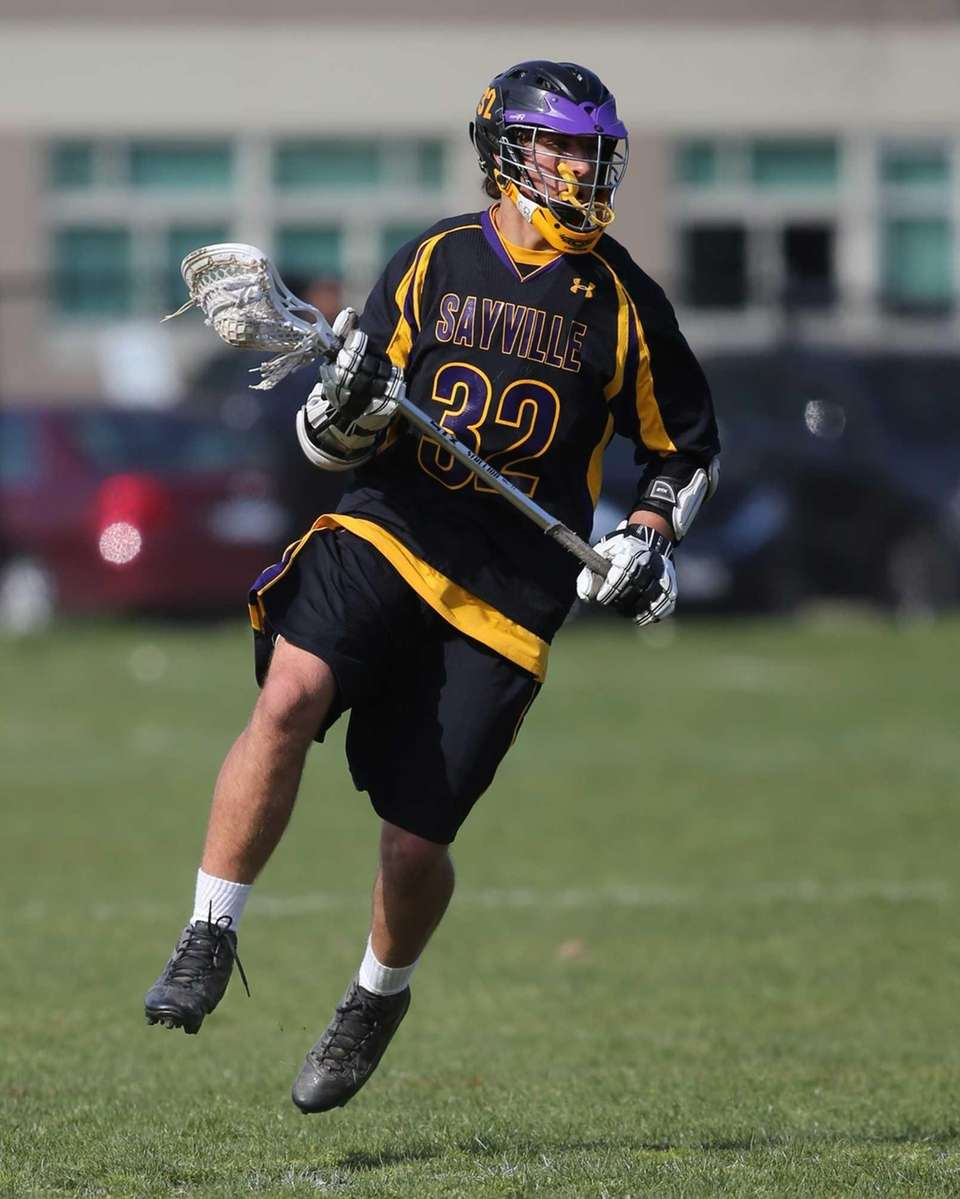 Sayville's Zack Sirico drives toward the goal in