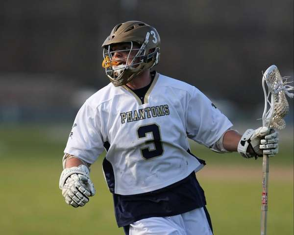 Bayport-Blue Point's Brian Ward moves the ball up