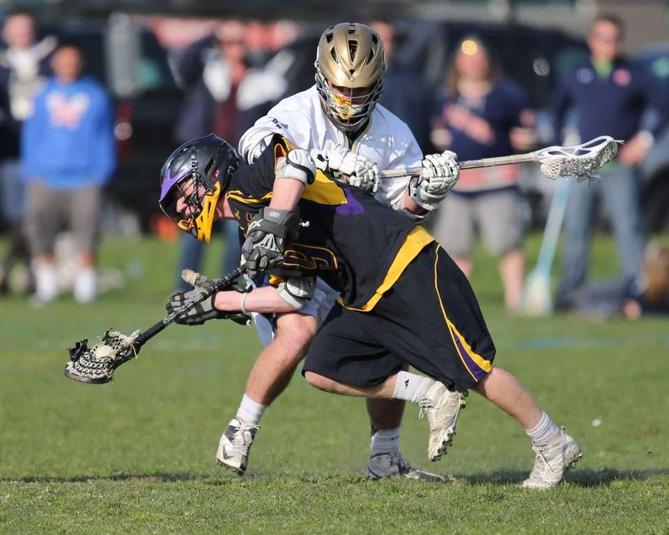 Sayville's Spencer Andrews wins the face-off against Bayport-