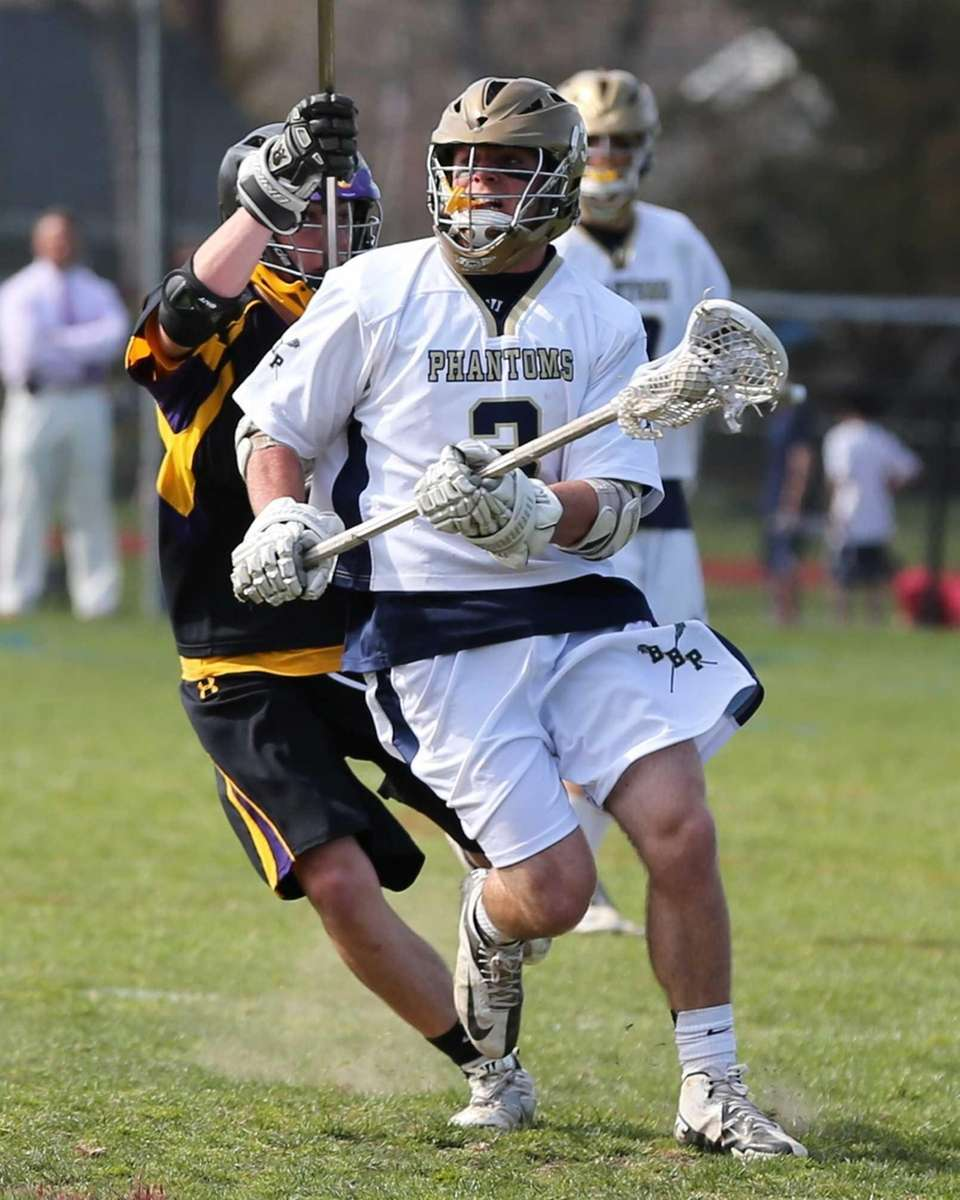 Bayport-Blue Point's Brian Ward drives toward the goal