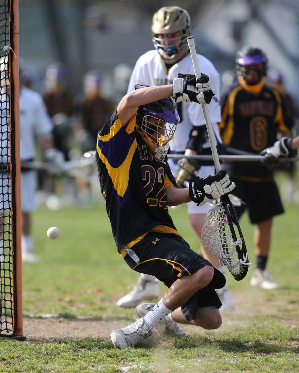 Sayville goalie Kyle O'Reilly deflects a point blank