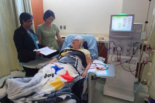 Lena Delligatti, getting dialysis, with RN Sarah Park