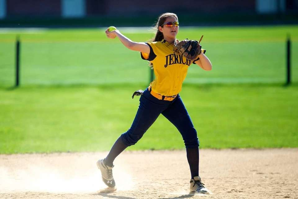 Jericho shortstop Nikki Micelotta throws out a runner