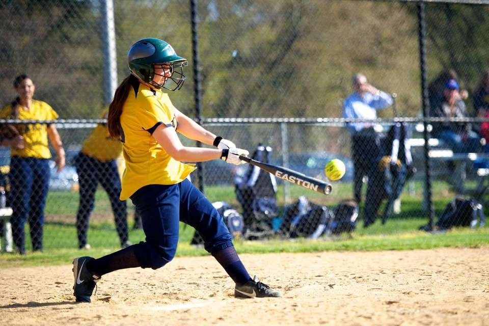 Jericho catcher Carlie Orenstein makes contact for a