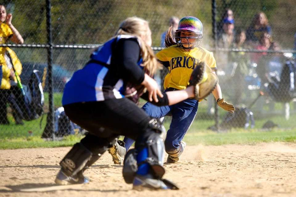 Jericho left fielder Rachel Herschhiemer is tagged out