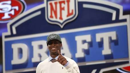 Geno Smith of West Virginia gestures after being