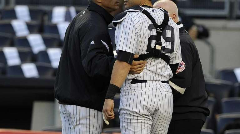 New York Yankees manager Joe Girardi takes out