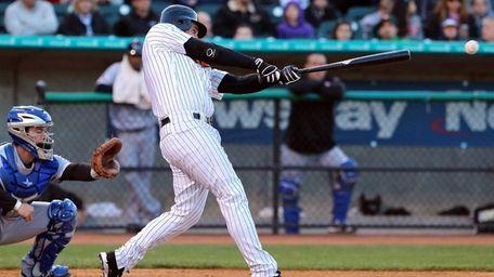Ducks batter Ben Broussard sends a double to