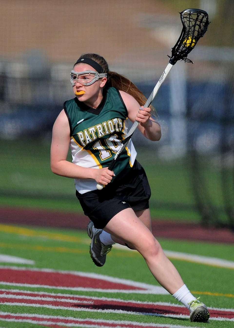 Ward Melville's Emily Rogers-Healion circles behind the net