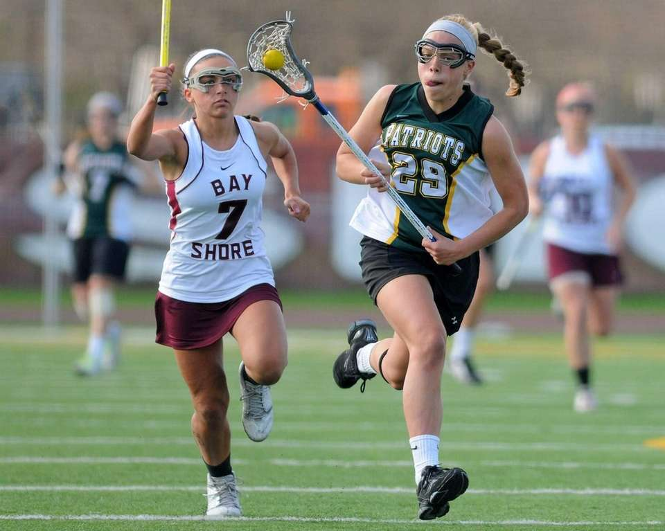 Ward Melville's Deryn Blaney, right, races downfield as