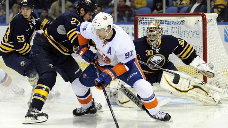 Sabres defenseman Adam Pardy tangles with New York